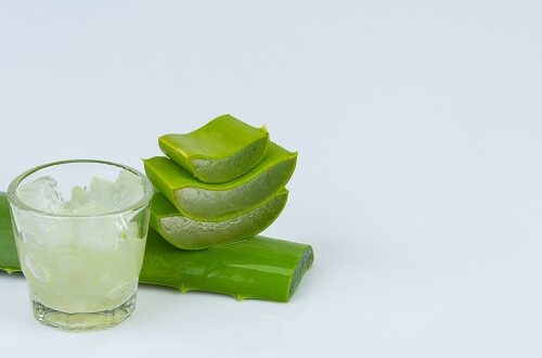 Jel of aloe vera in  a glass with aloe vera leave is near together on white background.
